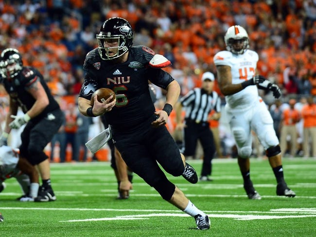 Dec 6, 2013; Detroit, MI, USA; Northern Illinois Huskies quarterback Jordan Lynch (6) rushes for a touchdown during the third quarter against the Bowling Green Falcons at Ford Field. Mandatory Credit: Andrew Weber-USA TODAY Sports