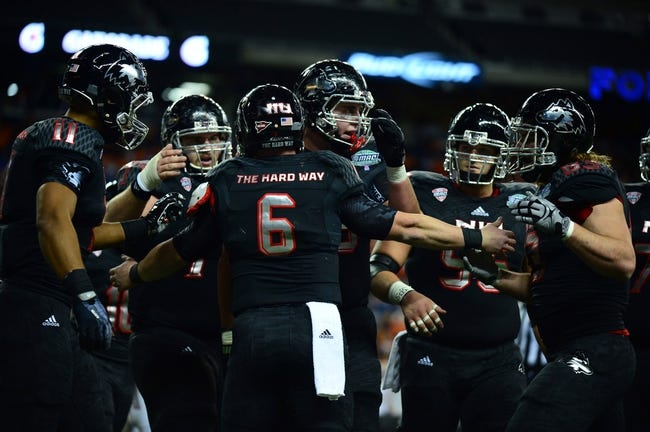 Dec 6, 2013; Detroit, MI, USA; Northern Illinois Huskies quarterback Jordan Lynch (6) celebrates with teammates after scoring a touchdown during the third quarter against the Bowling Green Falcons at Ford Field. Mandatory Credit: Andrew Weber-USA TODAY Sports