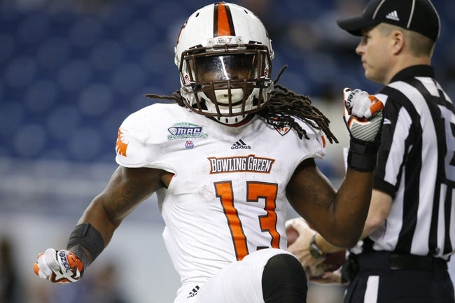 Dec 6, 2013; Detroit, MI, USA; Bowling Green Falcons running back Travis Greene (13) celebrates after scoring a touchdown in the fourth quarter against the Northern Illinois Huskies at Ford Field. Bowling Green won 47-27. Mandatory Credit: Rick Osentoski-USA TODAY Sports