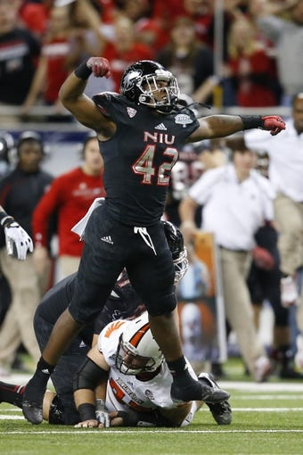 Dec 6, 2013; Detroit, MI, USA; Northern Illinois Huskies running back Cameron Stingily (42) celebrates a play in the third quarter against the Bowling Green Falcons at Ford Field. Bowling Green won 47-27. Mandatory Credit: Rick Osentoski-USA TODAY Sports
