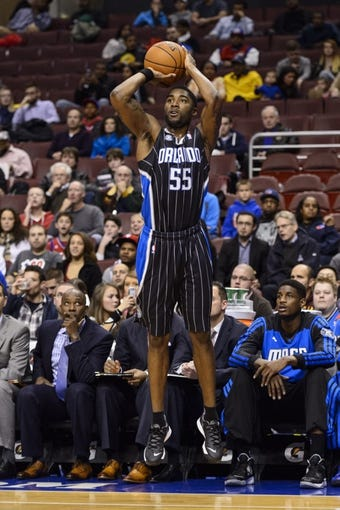 Dec 3, 2013; Philadelphia, PA, USA; Orlando Magic guard E'Twaun Moore (55) shoots a jump shot during the first quarter against the Philadelphia 76ers at the Wells Fargo Center. The Sixers defeated the Magic 126-125 in double overtime. Mandatory Credit: Howard Smith-USA TODAY Sports