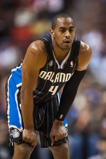 Dec 3, 2013; Philadelphia, PA, USA; Orlando Magic guard Arron Afflalo (4) during the first quarter against the Philadelphia 76ers at the Wells Fargo Center. The Sixers defeated the Magic 126-125 in double overtime. Mandatory Credit: Howard Smith-USA TODAY Sports