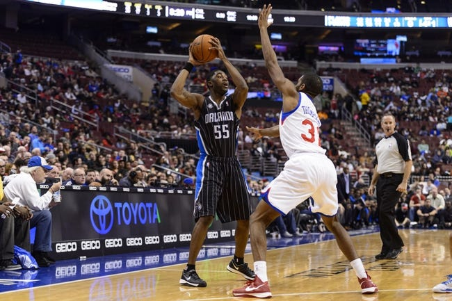 Dec 3, 2013; Philadelphia, PA, USA; Orlando Magic guard E'Twaun Moore (55) looks to pass while defended by Philadelphia 76ers forward Hollis Thompson (31) during the third quarter at the Wells Fargo Center. The Sixers defeated the Magic 126-125 in double overtime. Mandatory Credit: Howard Smith-USA TODAY Sports
