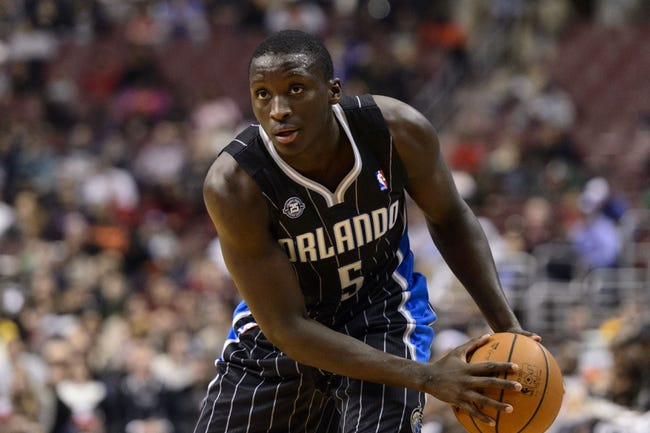 Dec 3, 2013; Philadelphia, PA, USA; Orlando Magic guard Victor Oladipo (5) during the second quarter against the Philadelphia 76ers at the Wells Fargo Center. The Sixers defeated the Magic 126-125 in double overtime. Mandatory Credit: Howard Smith-USA TODAY Sports