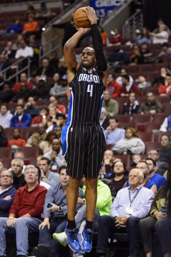 Dec 3, 2013; Philadelphia, PA, USA; Orlando Magic guard Arron Afflalo (4) shoots a jump shot during the third quarter against the Philadelphia 76ers at the Wells Fargo Center. The Sixers defeated the Magic 126-125 in double overtime. Mandatory Credit: Howard Smith-USA TODAY Sports