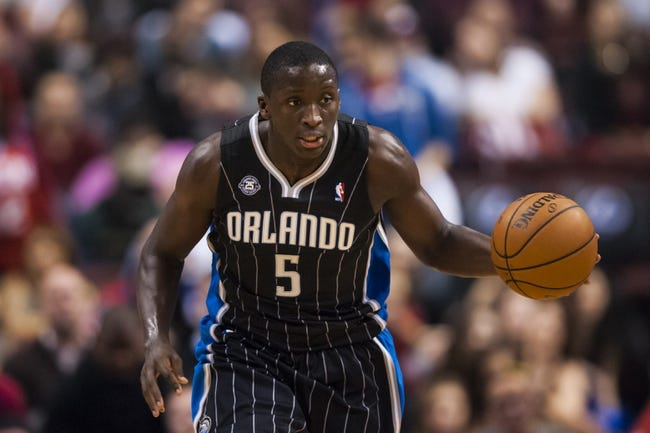 Dec 3, 2013; Philadelphia, PA, USA; Orlando Magic guard Victor Oladipo (5) brings the ball up court during the third quarter against the Philadelphia 76ers at the Wells Fargo Center. The Sixers defeated the Magic 126-125 in double overtime. Mandatory Credit: Howard Smith-USA TODAY Sports