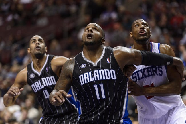 Dec 3, 2013; Philadelphia, PA, USA; Orlando Magic forward Glen Davis (11) boxes out Philadelphia 76ers forward Thaddeus Young (21) during the fourth quarter at the Wells Fargo Center. The Sixers defeated the Magic 126-125 in double overtime. Mandatory Credit: Howard Smith-USA TODAY Sports