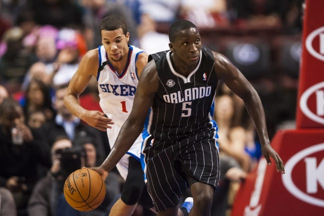 Dec 3, 2013; Philadelphia, PA, USA; Orlando Magic guard Victor Oladipo (5) is trailed by Philadelphia 76ers guard Michael Carter-Williams (1) during the third quarter at the Wells Fargo Center. The Sixers defeated the Magic 126-125 in double overtime. Mandatory Credit: Howard Smith-USA TODAY Sports