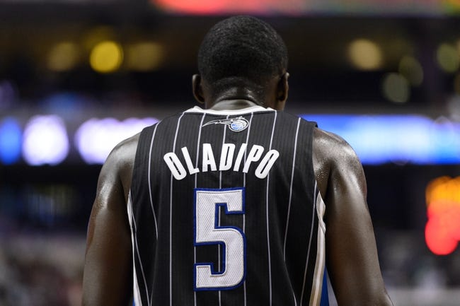 Dec 3, 2013; Philadelphia, PA, USA; Orlando Magic guard Victor Oladipo (5) during the fourth quarter against the Philadelphia 76ers at the Wells Fargo Center. The Sixers defeated the Magic 126-125 in double overtime. Mandatory Credit: Howard Smith-USA TODAY Sports