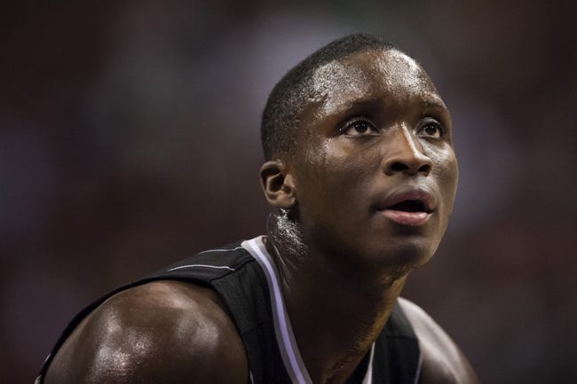 Dec 3, 2013; Philadelphia, PA, USA; Orlando Magic guard Victor Oladipo (5) during the third quarter against the Philadelphia 76ers at the Wells Fargo Center. The Sixers defeated the Magic 126-125 in double overtime. Mandatory Credit: Howard Smith-USA TODAY Sports