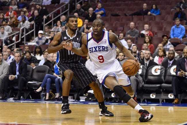 Dec 3, 2013; Philadelphia, PA, USA; Philadelphia 76ers guard James Anderson (9) is defended by Orlando Magic guard Ronnie Price (10) during overtime at the Wells Fargo Center. The Sixers defeated the Magic 126-125 in double overtime. Mandatory Credit: Howard Smith-USA TODAY Sports