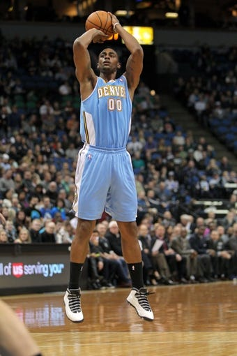 Nov 27, 2013; Minneapolis, MN, USA; Denver Nuggets forward Darrell Arthur (00) against the Minnesota Timberwolves at Target Center. The Nuggets defeated the Timberwolves 117-110. Mandatory Credit: Brace Hemmelgarn-USA TODAY Sports