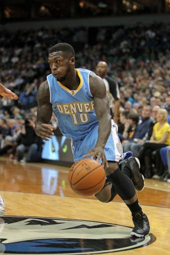 Nov 27, 2013; Minneapolis, MN, USA; Denver Nuggets guard Nate Robinson (10) against the Minnesota Timberwolves at Target Center. The Nuggets defeated the Timberwolves 117-110. Mandatory Credit: Brace Hemmelgarn-USA TODAY Sports