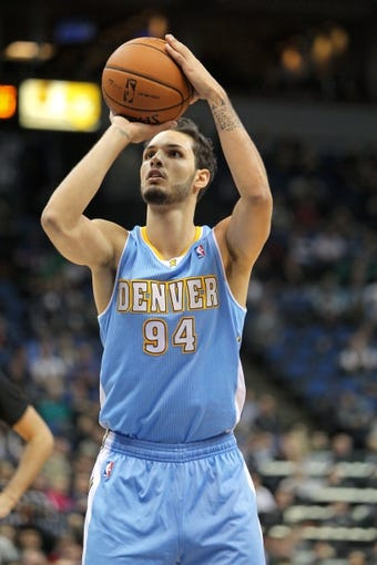 Nov 27, 2013; Minneapolis, MN, USA; Denver Nuggets guard Evan Fournier (94) against the Minnesota Timberwolves at Target Center. The Nuggets defeated the Timberwolves 117-110. Mandatory Credit: Brace Hemmelgarn-USA TODAY Sports