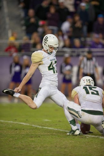 Nov 30, 2013; Fort Worth, TX, USA; Baylor Bears kicker Aaron Jones (43) kicks a field goal during the game against the TCU Horned Frogs at Amon G. Carter Stadium. The Bears defeated the Horned Frogs 41-38. Mandatory Credit: Jerome Miron-USA TODAY Sports