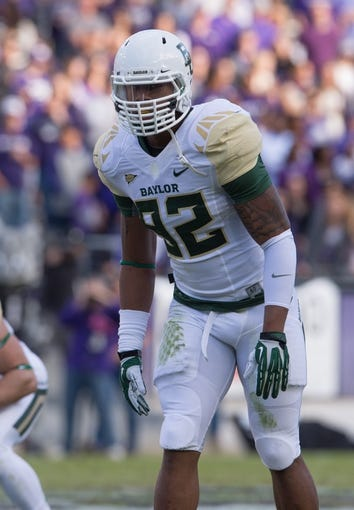 Nov 30, 2013; Fort Worth, TX, USA; Baylor Bears defensive end Jamal Palmer (92) faces the TCU Horned Frogs during the game at Amon G. Carter Stadium. The Bears defeated the Horned Frogs 41-38. Mandatory Credit: Jerome Miron-USA TODAY Sports