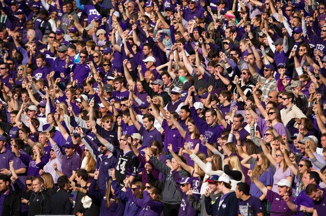 Nov 30, 2013; Fort Worth, TX, USA; The TCU Horned Frogs students and fans during the game against the Baylor Bears at Amon G. Carter Stadium. The Bears defeated the Horned Frogs 41-38. Mandatory Credit: Jerome Miron-USA TODAY Sports