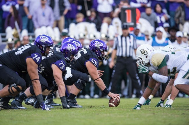 Nov 30, 2013; Fort Worth, TX, USA; The TCU Horned Frogs face the Baylor Bears during the game at Amon G. Carter Stadium. The Bears defeated the Horned Frogs 41-38. Mandatory Credit: Jerome Miron-USA TODAY Sports