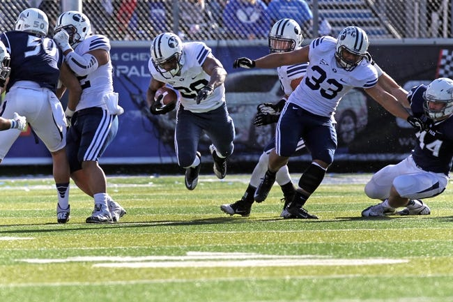 Nov 30, 2013; Reno, NV, USA; BYU Cougars running back Adam Hine (28) runs in the first half of their NCAA football game with Nevada Wolf Pack at MacKay Stadium. Mandatory Credit: Lance Iversen/USA TODAY Sports. BYU won 28-23.