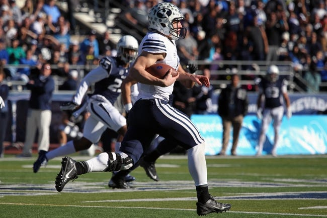 Nov 30, 2013; Reno, NV, USA; BYU Cougars quarterback Taysom Hill runs for a first down in the first half of their NCAA football game with Nevada Wolf Pack at MacKay Stadium. Mandatory Credit: Lance Iversen/USA TODAY Sports. BYU won 28-23.