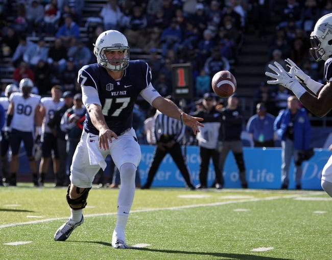 Nov 30, 2013; Reno, NV, USA; Nevada Wolf Pack quarterback Cody Fajardo (17) runs a play against the BYU Cougars in their NCAA football game at MacKay Stadium. Mandatory Credit: Lance Iversen/USA TODAY Sports. BYU won 28-23.