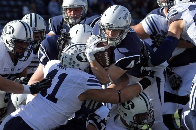 Nov 30, 2013; Reno, NV, USA; Nevada Wolf Pack running back Kendall Brock (4) dives into the end zone for a first quarter touchdown against the BYU Cougars at MacKay Stadium. Mandatory Credit: Lance Iversen/USA TODAY Sports