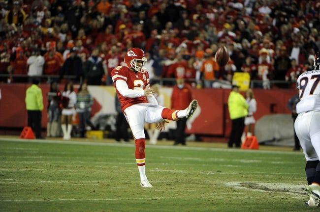 Dec 1, 2013; Kansas City, MO, USA; Kansas City Chiefs punter Dustin Colquitt (2) punts against the Denver Broncos in the second half at Arrowhead Stadium. Denver won the game 35-28. Mandatory Credit: John Rieger-USA TODAY Sports
