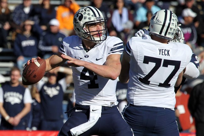 Nov 30, 2013; Reno, NV, USA; BYU Cougars quarterback Taysom Hill runs a pass play in the first half of their NCAA football game with Nevada Wolf Pack at MacKay Stadium. Mandatory Credit: Lance Iversen/USA TODAY Sports. BYU won 28-23.