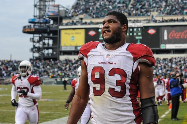 Dec 1, 2013; Philadelphia, PA, USA;  Arizona Cardinals defensive end Calais Campbell (93) heads to the locker room for half time during the game against the Philadelphia Eagles at Lincoln Financial Field. Mandatory Credit: John Geliebter-USA TODAY Sports
