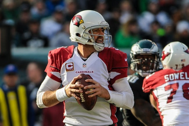 Dec 1, 2013; Philadelphia, PA, USA;  Arizona Cardinals quarterback Carson Palmer (3) looks for an open receiver in the second quarter against the Philadelphia Eagles at Lincoln Financial Field. Mandatory Credit: John Geliebter-USA TODAY Sports