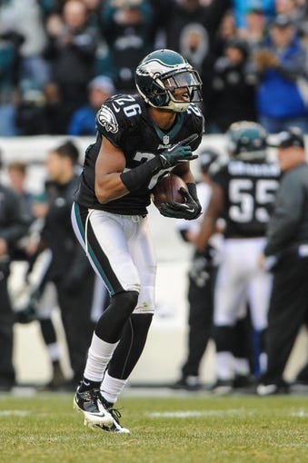 Dec 1, 2013; Philadelphia, PA, USA;  Philadelphia Eagles cornerback Cary Williams (26) celebrates his third quarter interception during the game against the Arizona Cardinals at Lincoln Financial Field. The Philadelphia Eagles won the game 24-21.  Mandatory Credit: John Geliebter-USA TODAY Sports