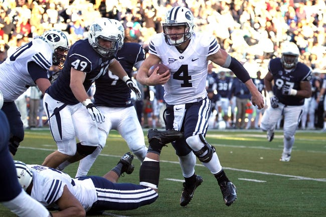 Nov 30, 2013; Reno, NV, USA; BYU Cougars quarterback Taysom Hill runs for a touchdown in the late into second half of their NCAA football game with Nevada Wolf Pack at MacKay Stadium. Mandatory Credit: Lance Iversen/USA TODAY Sports. BYU won 28-23.