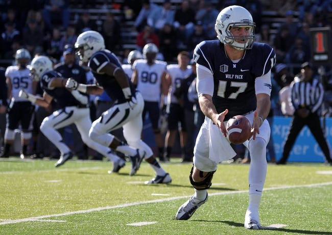 Nov 30, 2013; Reno, NV, USA; Nevada Wolf Pack quarterback Cody Fajardo (17) runs a play in the first half against the BYU Cougars in their NCAA football game at MacKay Stadium. Mandatory Credit: Lance Iversen/USA TODAY Sports. BYU won 28-23.