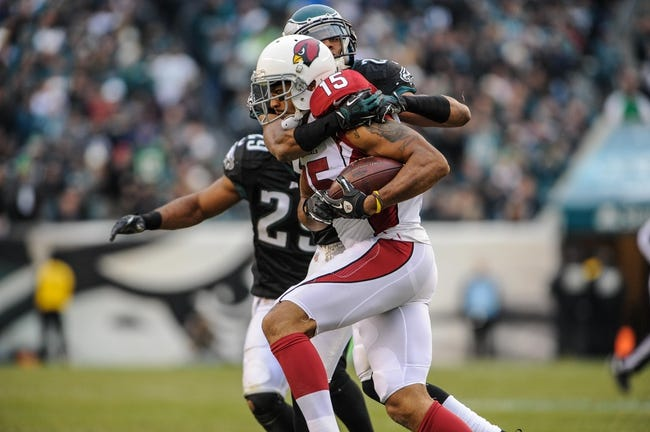 Dec 1, 2013; Philadelphia, PA, USA;  Philadelphia Eagles cornerback Cary Williams (26) tackles Arizona Cardinals wide receiver Michael Floyd (15) in the third quarter of the game at Lincoln Financial Field. The Philadelphia Eagles won the game 24-21.  Mandatory Credit: John Geliebter-USA TODAY Sports