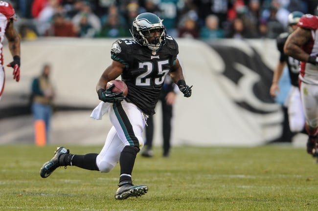 Dec 1, 2013; Philadelphia, PA, USA;  Philadelphia Eagles running back LeSean McCoy (25) carries the ball during the third quarter of the game against the Arizona Cardinals at Lincoln Financial Field. The Philadelphia Eagles won the game 24-21.  Mandatory Credit: John Geliebter-USA TODAY Sports
