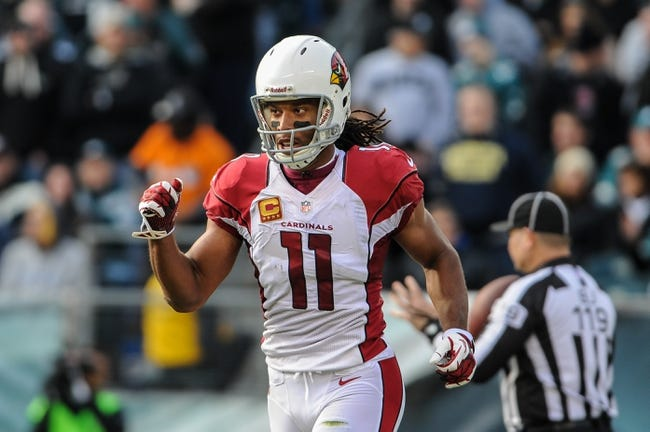 Dec 1, 2013; Philadelphia, PA, USA;  Arizona Cardinals wide receiver Larry Fitzgerald (11) celebrates his second quarter touchdown during the game against the Philadelphia Eagles at Lincoln Financial Field. Mandatory Credit: John Geliebter-USA TODAY Sports