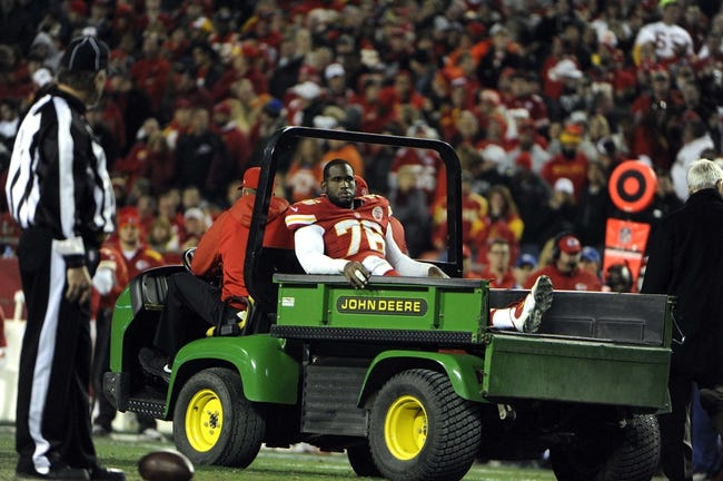 Dec 1, 2013; Kansas City, MO, USA; Kansas City Chiefs tackle Branden Albert (76) is taken off the field against the Denver Broncos in the second half at Arrowhead Stadium. Denver won the game 35-28. Mandatory Credit: John Rieger-USA TODAY Sports