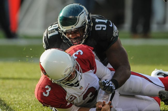 Dec 1, 2013; Philadelphia, PA, USA;  Philadelphia Eagles defensive end Fletcher Cox (91) brings Arizona Cardinals quarterback Carson Palmer (3) down after a pass in the second quarter at Lincoln Financial Field. Mandatory Credit: John Geliebter-USA TODAY Sports