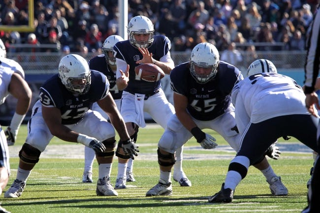 Nov 30, 2013; Reno, NV, USA; Nevada Wolf Pack quarterback Cody Fajardo (17) runs play against the BYU Cougars in their NCAA football game at MacKay Stadium. Mandatory Credit: Lance Iversen/USA TODAY Sports. BYU won 28-23.