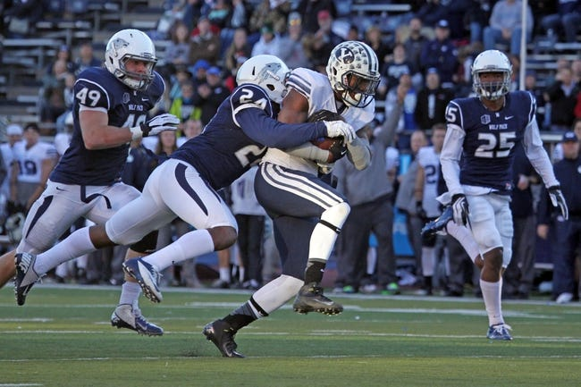 Nov 30, 2013; Reno, NV, USA; BYU Cougars running back Jamaal Williams (21) runs for a late fourth quarter first down against Nevada Wolf Pack during their NCAA football game at MacKay Stadium. Mandatory Credit: Lance Iversen/USA TODAY Sports. BYU won 28-23.
