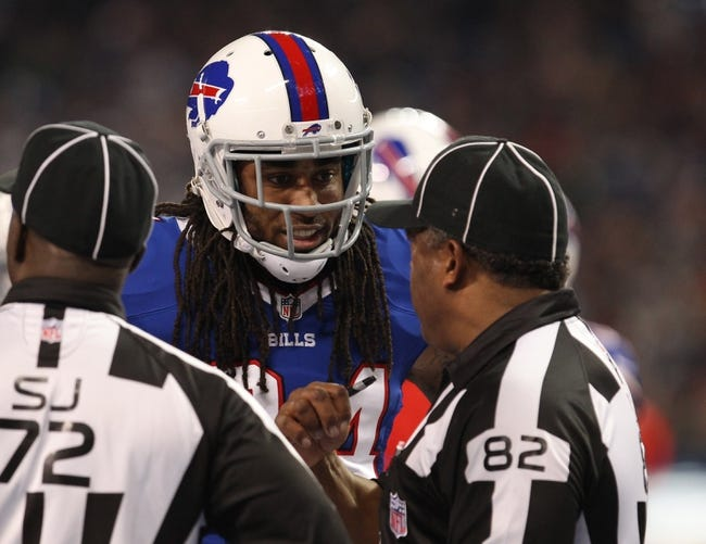 Dec 1, 2013; Toronto, ON, Canada; Buffalo Bills cornerback Stephon Gilmore (24) talks to field judge Buddy Horton (82) during a stoppage in play during a game against the Atlanta Falcons at the Rogers Center. Falcons beat the Bills 34 to 31 in overtime.  Mandatory Credit: Timothy T. Ludwig-USA TODAY Sports