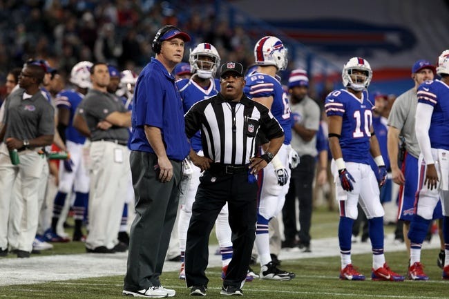 Dec 1, 2013; Toronto, ON, Canada; Buffalo Bills head coach Doug Marrone talks to field judge Buddy Horton (82) during a stoppage in play against the Atlanta Falcons at the Rogers Center. Mandatory Credit: Timothy T. Ludwig-USA TODAY Sports