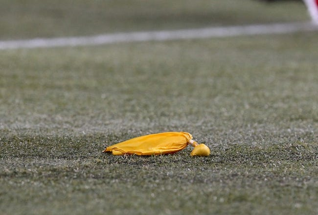 Dec 1, 2013; Toronto, ON, Canada; A general view of a penalty flag thrown by a referee during a game between the Buffalo Bills and the Atlanta Falcons at the Rogers Center. Mandatory Credit: Timothy T. Ludwig-USA TODAY Sports