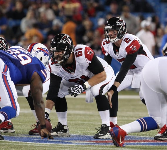 Dec 1, 2013; Toronto, ON, Canada; Atlanta Falcons center Joe Hawley (61) waits to snap the ball to quarterback Matt Ryan (2) against the Buffalo Bills at the Rogers Center. Mandatory Credit: Timothy T. Ludwig-USA TODAY Sports