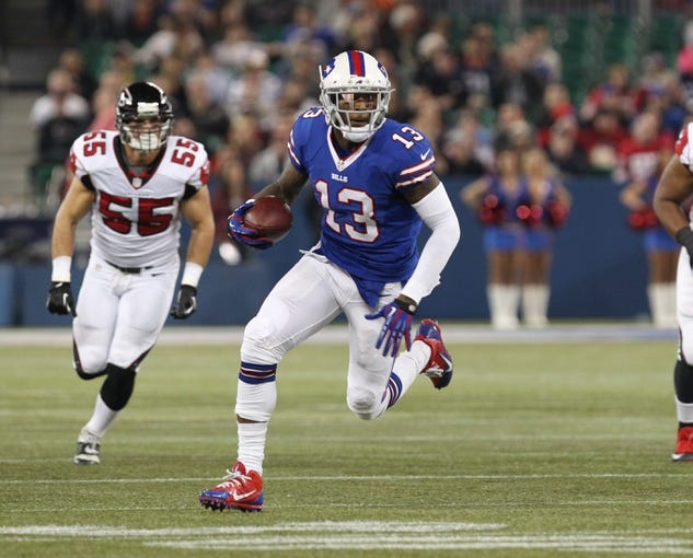 Dec 1, 2013; Toronto, ON, Canada; Buffalo Bills wide receiver Steve Johnson (13) runs the ball against the Atlanta Falcons at the Rogers Center. Mandatory Credit: Timothy T. Ludwig-USA TODAY Sports