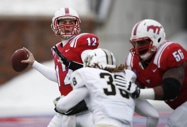Dec 7, 2013; Dallas, TX, USA; Southern Methodist Mustangs quarterback Neal Burcham (12) throws a pass against the UCF Knights during the first half of an NCAA football game at Gerald J. Ford Stadium. Mandatory Credit: Jim Cowsert-USA TODAY Sports
