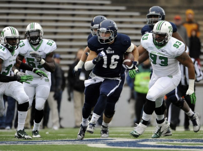 Dec 7, 2013; Houston, TX, USA; Rice Owls quarterback Taylor McHargue (16) carries the ball chased by Marshall Thundering Herd linebacker Evan McKelvey (31) and defensive end Alex Bazzie (53) and defensive tackle Steve Dillon (93) during the first half at Rice Stadium. Mandatory Credit: Brendan Maloney-USA TODAY Sports