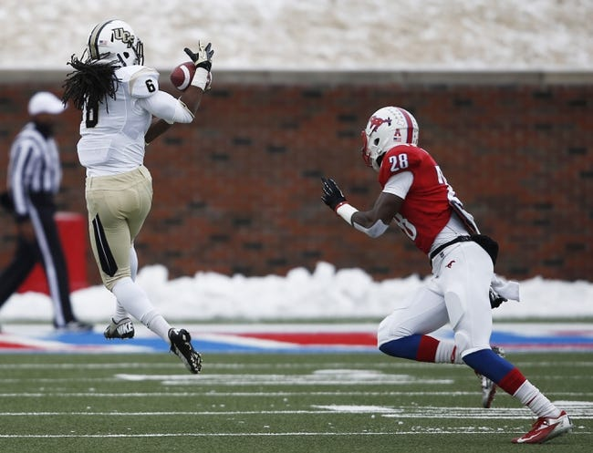 Dec 7, 2013; Dallas, TX, USA; UCF Knights wide receiver Rannell Hall (6) makes a catch in front of Southern Methodist Mustangs defensive back Shakiel Randolph (28) during the first half of an NCAA football game at Gerald J. Ford Stadium. Mandatory Credit: Jim Cowsert-USA TODAY Sports