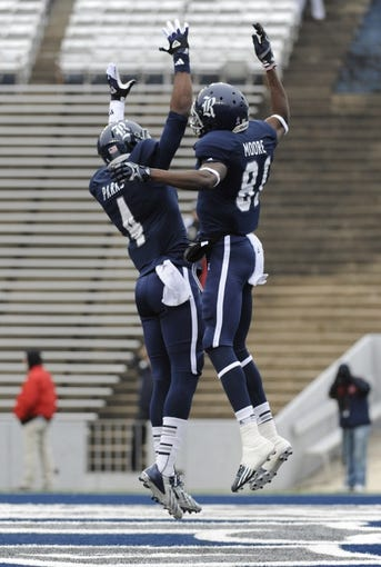 Dec 7, 2013; Houston, TX, USA; Rice Owls wide receivers Donte Moore (81) and Dennis Parks (4) react after a touchdown against the Marshall Thundering Herd during the first half at Rice Stadium. Mandatory Credit: Brendan Maloney-USA TODAY Sports