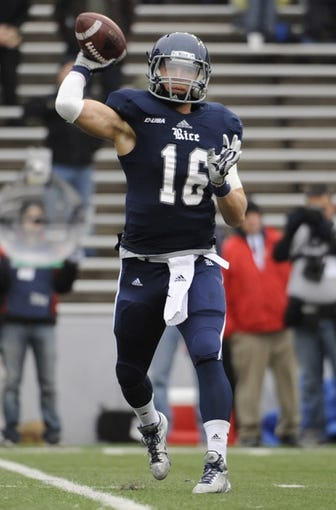 Dec 7, 2013; Houston, TX, USA; Rice Owls quarterback Taylor McHargue (16) psses against the Marshall Thundering Herd during the first half at Rice Stadium. Mandatory Credit: Brendan Maloney-USA TODAY Sports